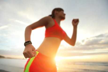 http://www.dreamstime.com/stock-image-health-sport-woman-smart-watch-young-run-wear-device-focus-beach-sunrise-asian-image44361061